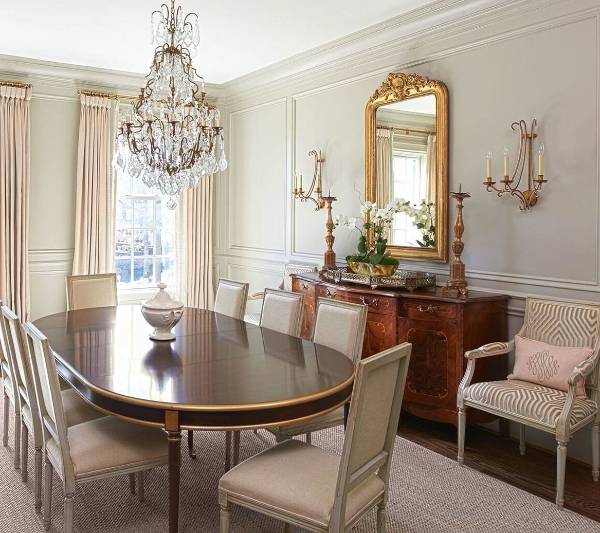 Schumacher fabric brings an elegant touch to the dining room on window treatments and upholstered chairs. The table is from Hickory Chair.