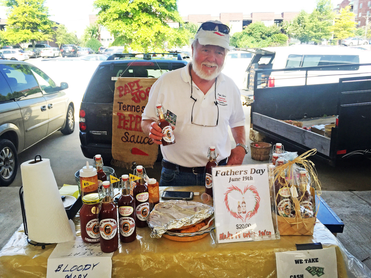 Papi Joe shows off his delicious pepper sauce, $11.