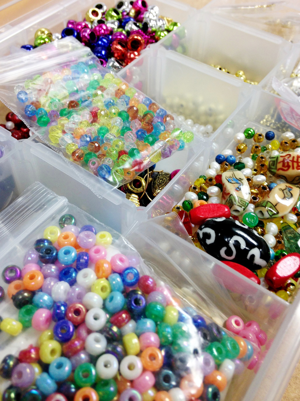 A tray of colorful beads offers more possibilities for personalizing creative needlepoint projects.