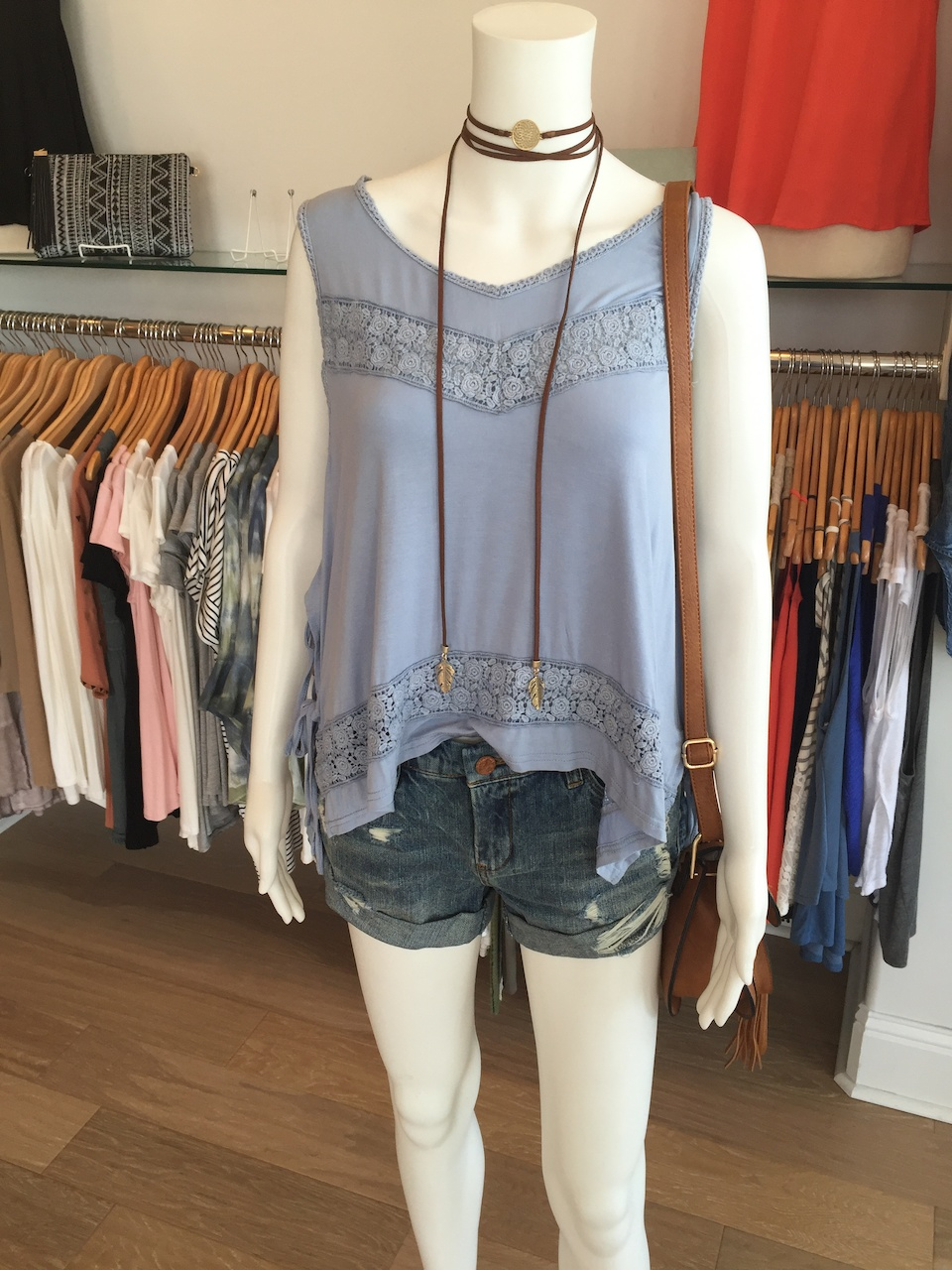 Flowy tank and denim shorts are a cool combination for Music Fest.