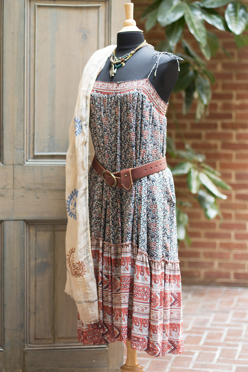 Paisley embroidered linen scarf, $150; Ulla Johnson bohemian print dress, $438; Brass buckled leather belt, $155, Braided vintage beaded necklaces, $245 and $290