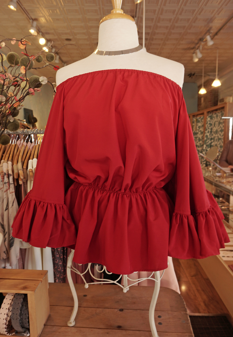 "From <a href=""https://styleblueprint.com/louisville/guide/general-eccentric/"" target=""_blank"">General Eccentric</a>: Red off-the-shoulder top, $38; Choker, $9"