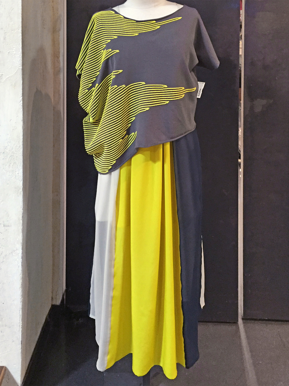 From Betsy Prince: Christian Wijants yellow and night blue silk dress, $641; Crea Concept yellow asymmetrical top, $338