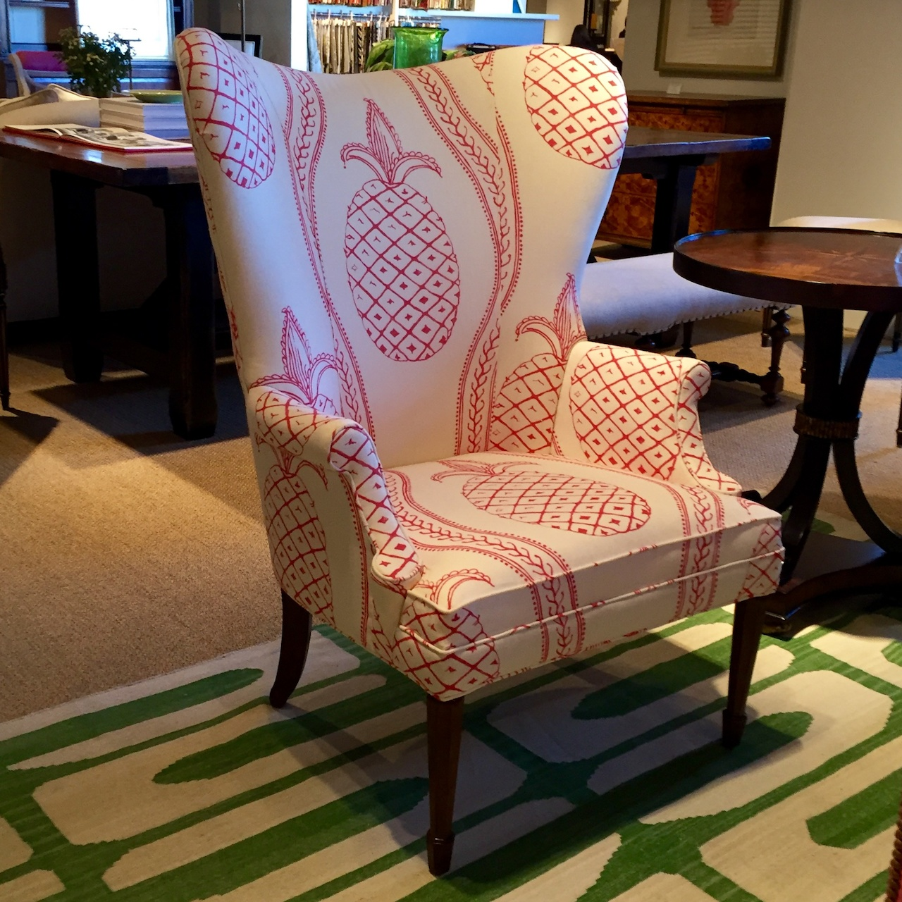 A great example of new traditional: A wing chair gets a modern update with a large-scale pattern.