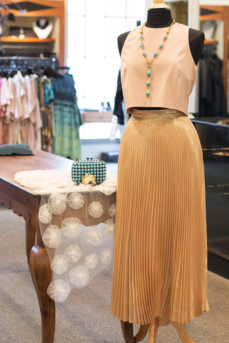 From Kittie Kyle: https://styleblueprint.com/memphis/guide/kittie-kyle/ Nicole Miller pleated metallic skirt, $395; Nicole Miller crop top, $188; Murna Halperin gold and turquoise necklace, $165; Brass emerald cuff, $330; Silk scarf, $150