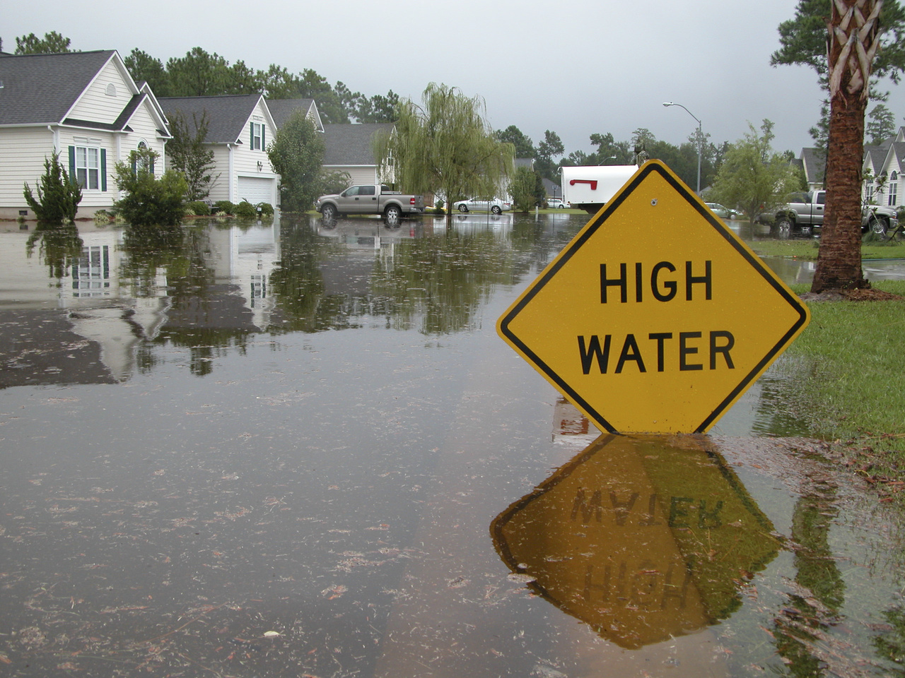 """Flooded road with """"high water"""" sign"""