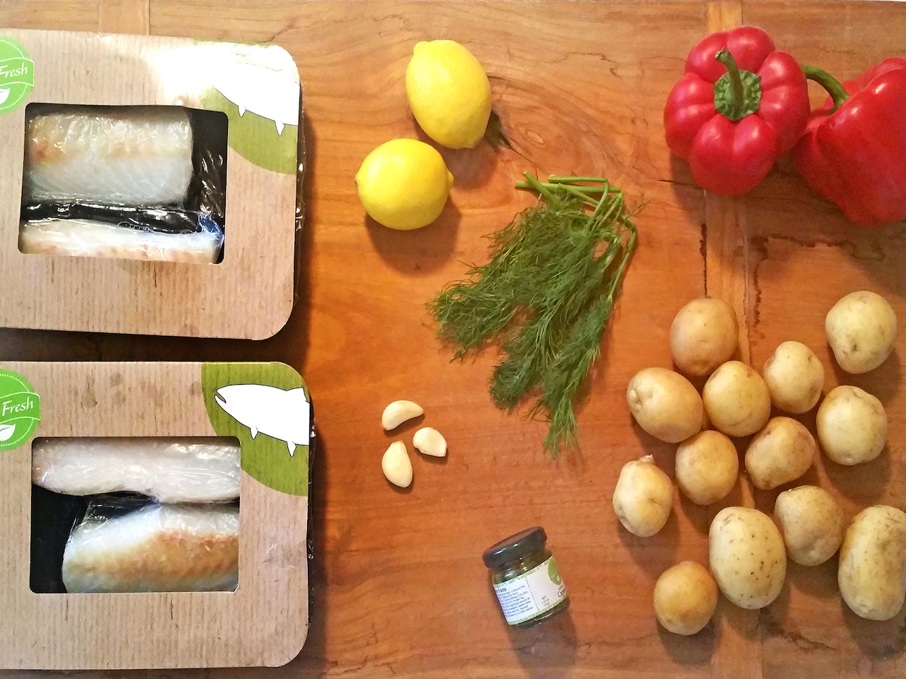 "The ingredients for the cod en papillote. Cooking ""en papillote"" is French technique in which food is cooked inside a parchment, or foil, envelope, trapping and steaming all the flavors in the pouch."