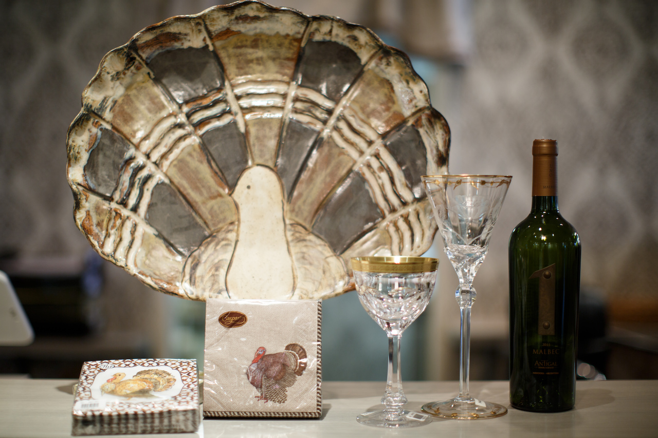 From Babcock Gifts: Etta B Pottery turkey, $128; Roseanne Beck Collection cocktail napkins and Caspari cocktail napkins, $5.25 pack and gold-edged stemware, $275 and $640 each.