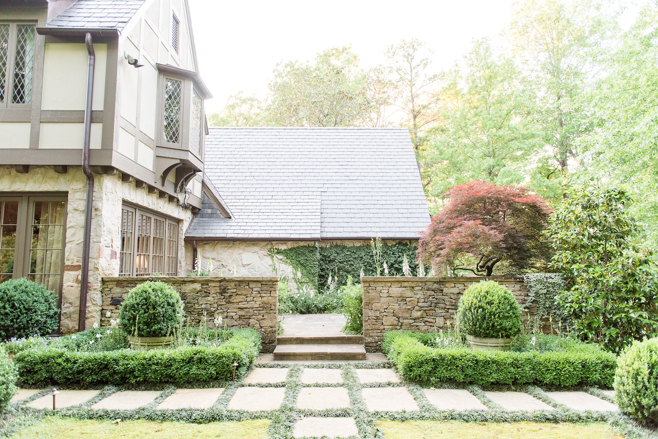 """""""The plantings along the facades of the house of boxwoods and mondo were used to simplify and unify the plantings,"""" says John. """"This approach is a classic look that can work well with almost any style of house."""""""