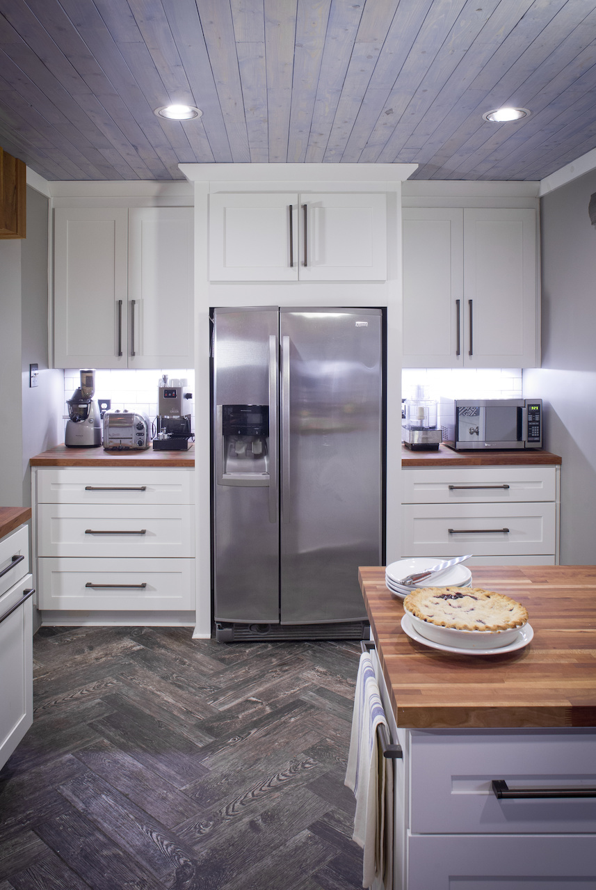 Very inch of space is utilized for storage and function, including the counters on either side of the refrigerator, which feature kitchen essentials. Image| Justin Fox Burks