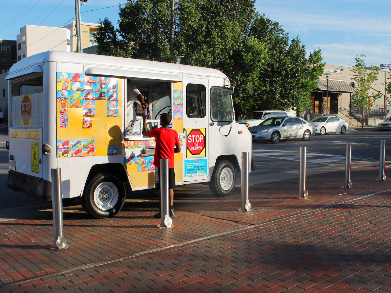 The ice cream truck often visits the park to offer sweet icy treats to parents and kids alike.