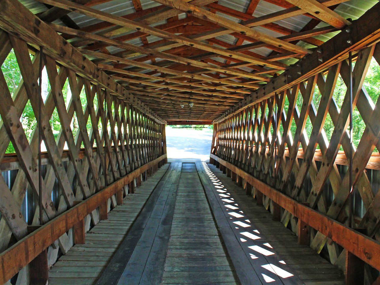 The interior of a covered bridge offers respite from the summer sun!