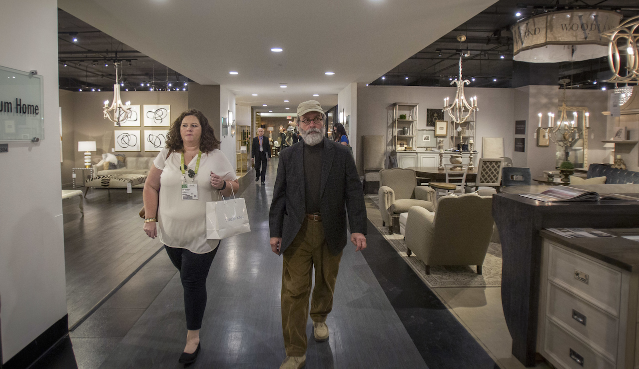Stacy and Michael move through the first few floors of the IHFC with focus; they know exactly which exhibitors they will visit, from lighting vendors to outdoor furniture companies.
