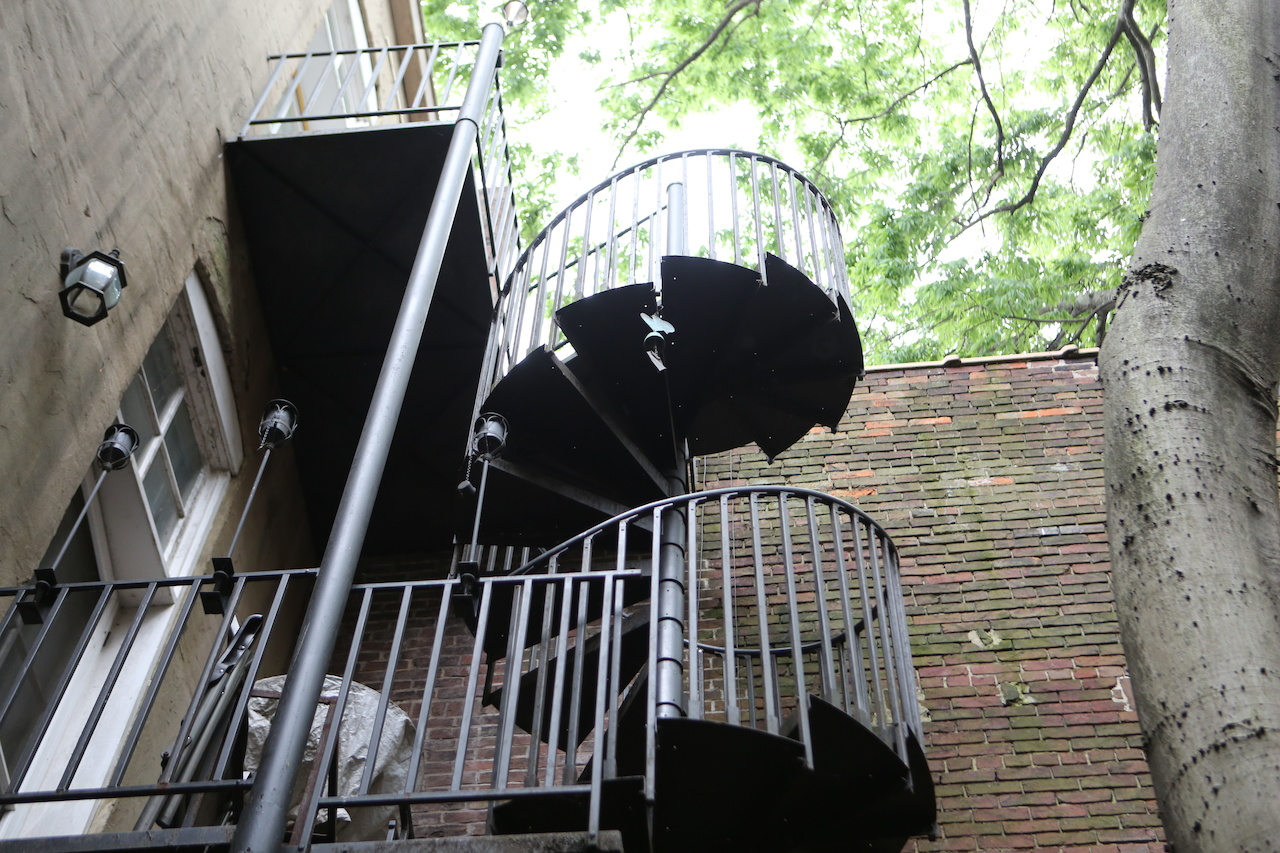 We wandered out into a courtyard just off a shop and discovered this three-story spiral staircase seemingly going straight up into the sky.