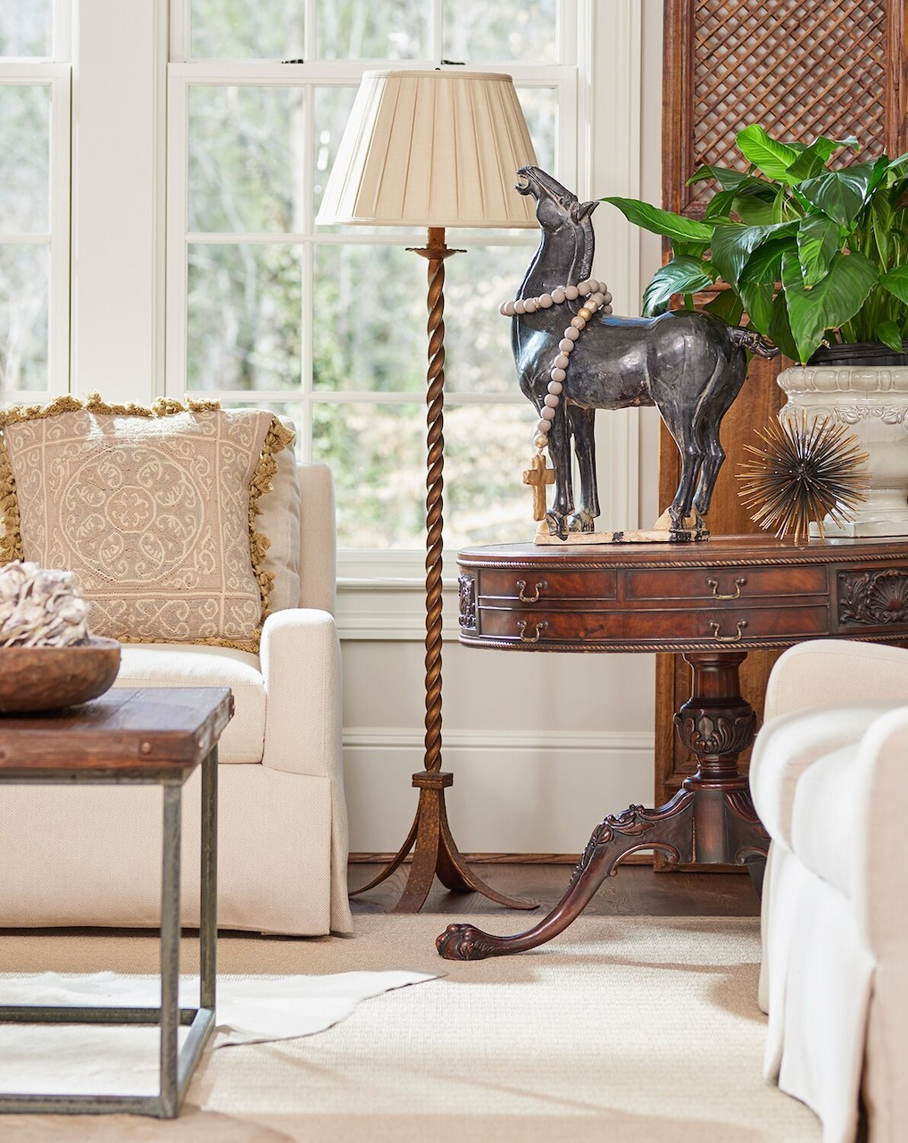 An antique table adds the patina of old wood to the family room.