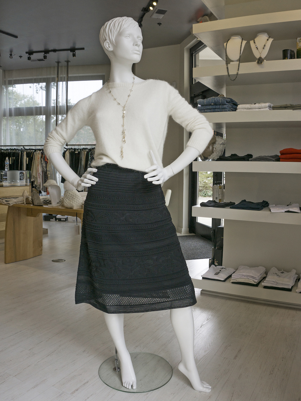 White sweater, $325; Missoni knit black A-line skirt, $675; Necklace, $525