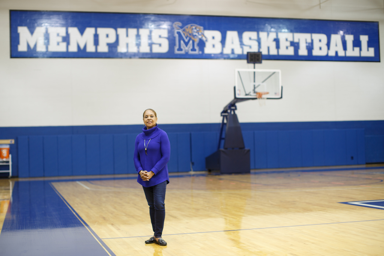 Donna is a surrogate mom for the 15 athletes who make up the men's basketball team.