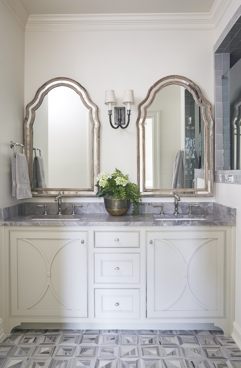 """""""You can always dress up your cabinets by adding a design on front of doors,"""" says Libby. The floors are a geometric mosaic honed marble from Fixtures and Finishes."""