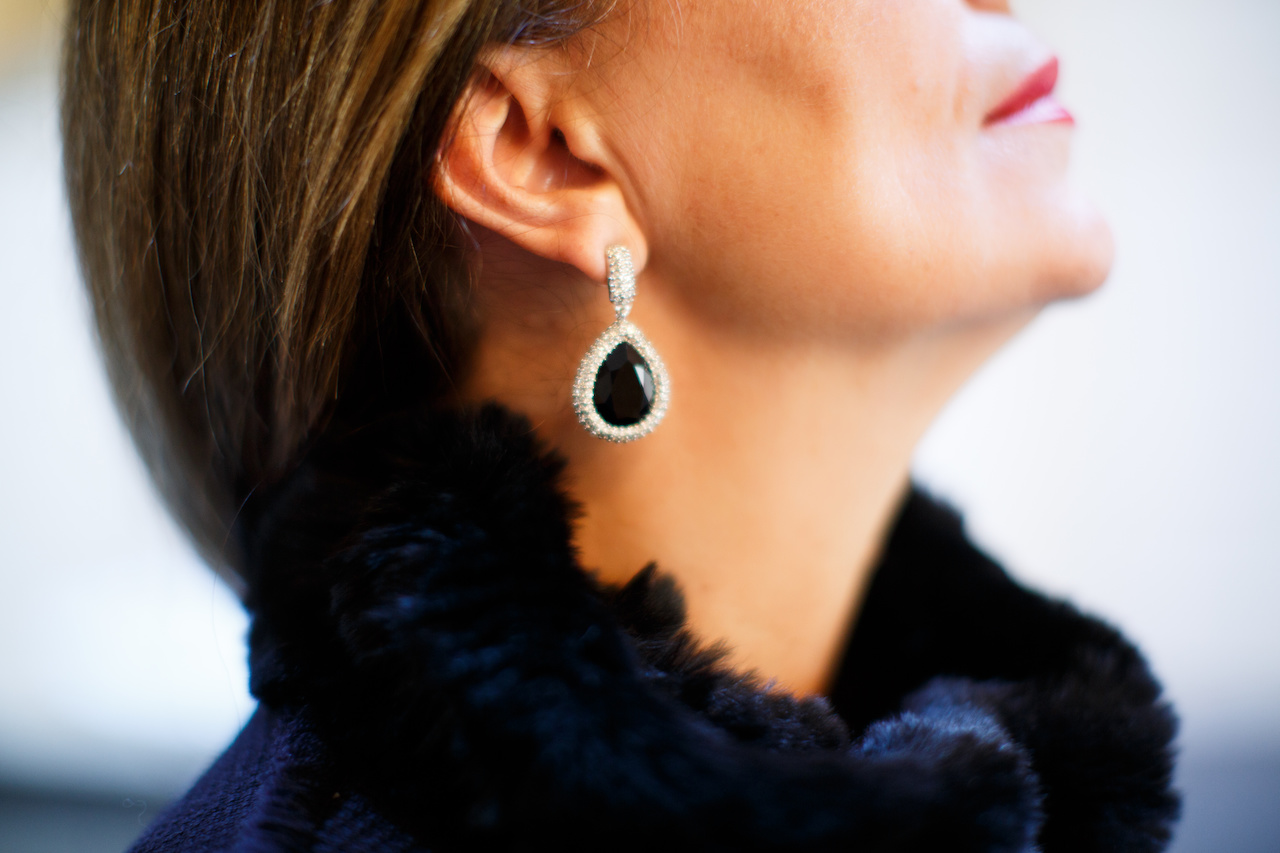 The Jocelyn Black Fur Bib, $165 and and St. John Earrings, $195 add a luxurious and classic accent to Anca's outfit.