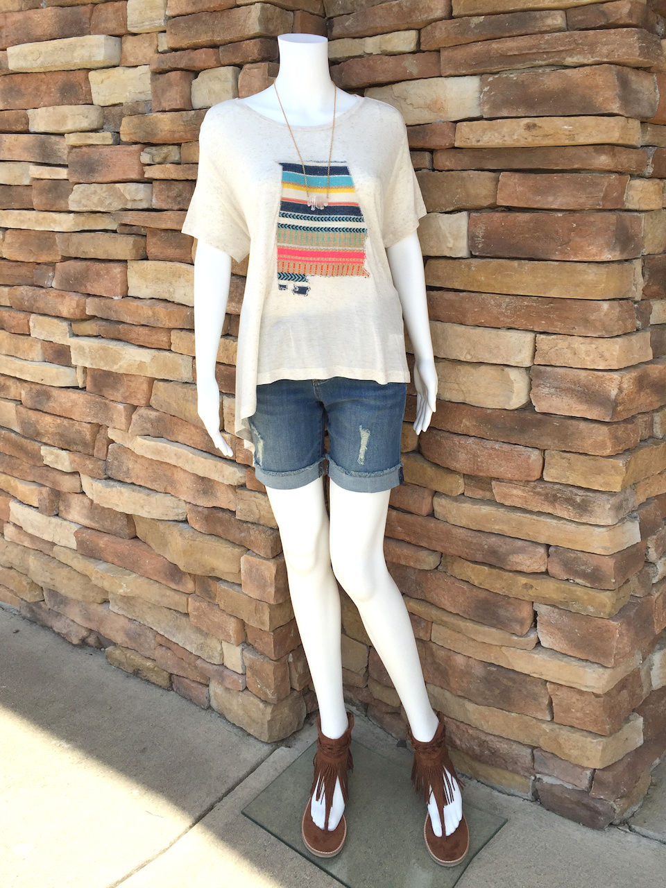 From Rogers Trading Company: Judith March flowy cream tee with embroidered Alabama state, $49.99; rolled cuff medium wash boyfriend short, $68.99