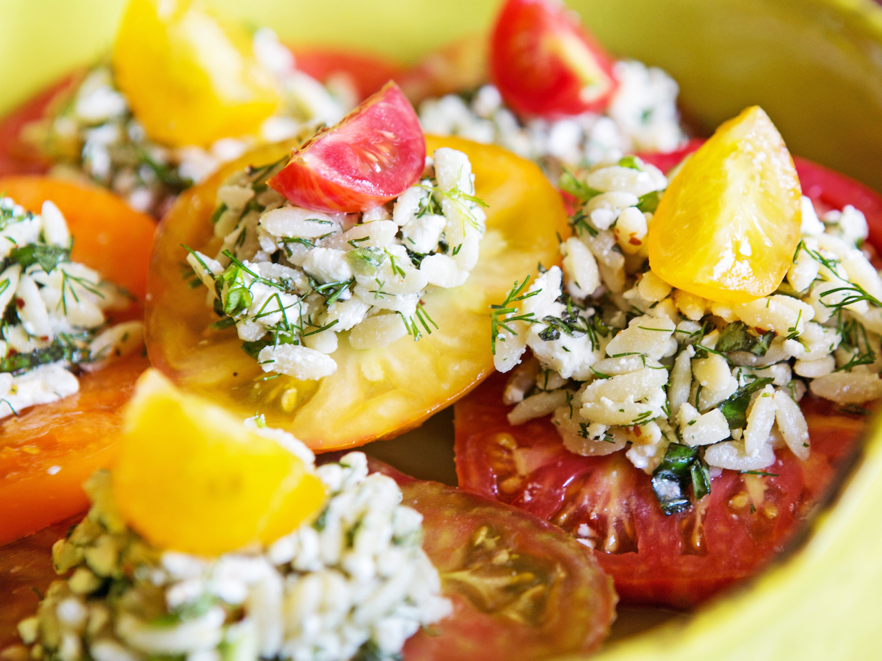Finish each orzo salad-topped tomato with an alternating colored cherry tomato for a truly eye-catching dish!