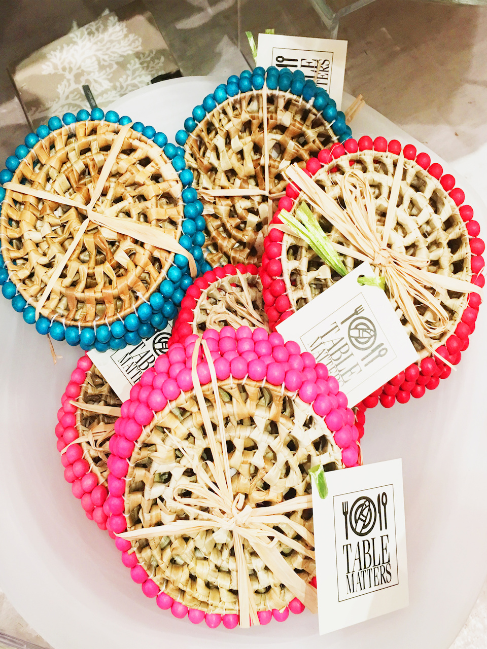 Colorful coasters, $24 per pack of 4, at Table Matters