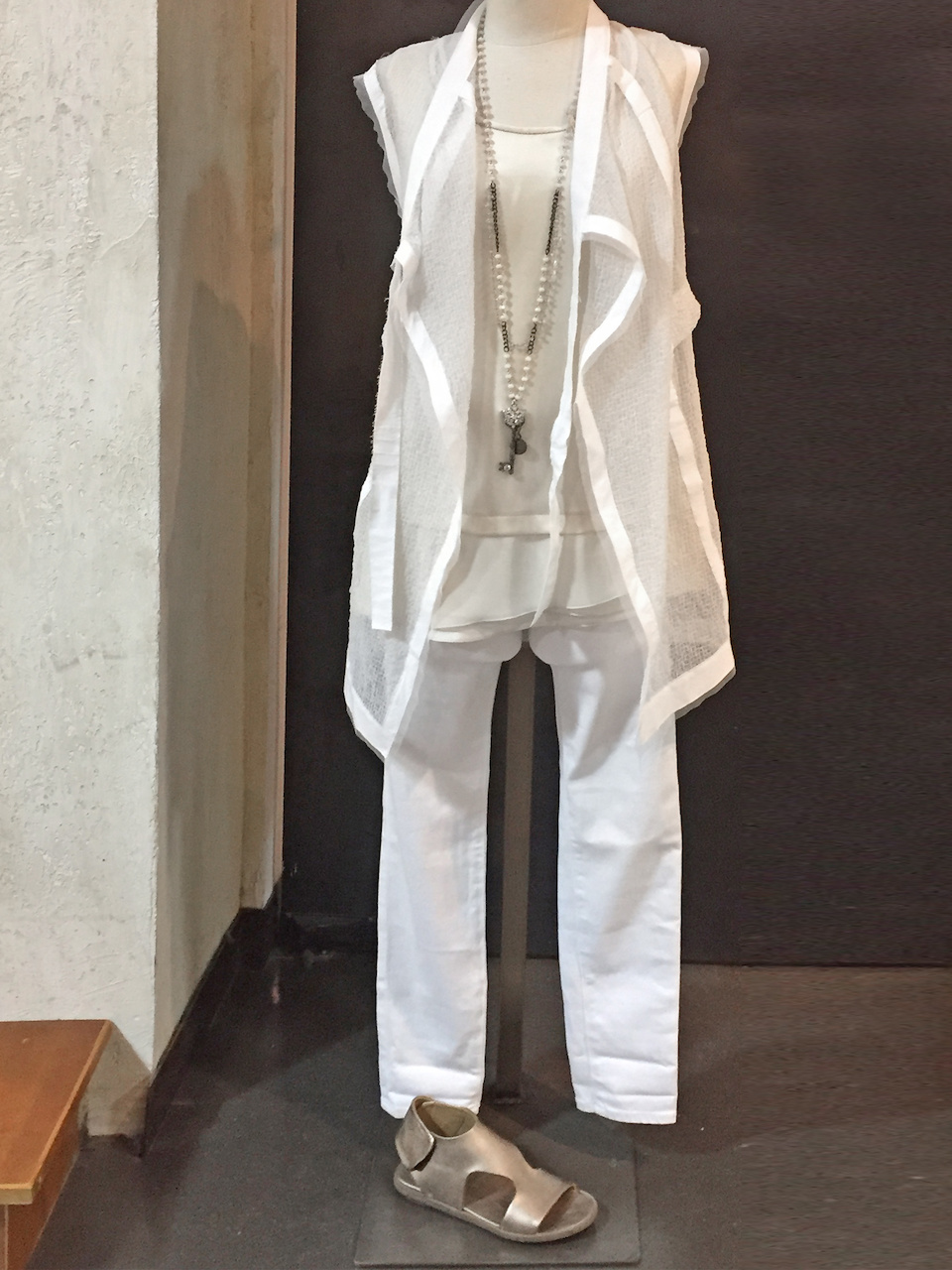 From Betsy Prince: Demoo white sleeveless vest, $438; AG Farrah Skinny jean in white, $178; Rocco Ragni cream sleeveless top, $330