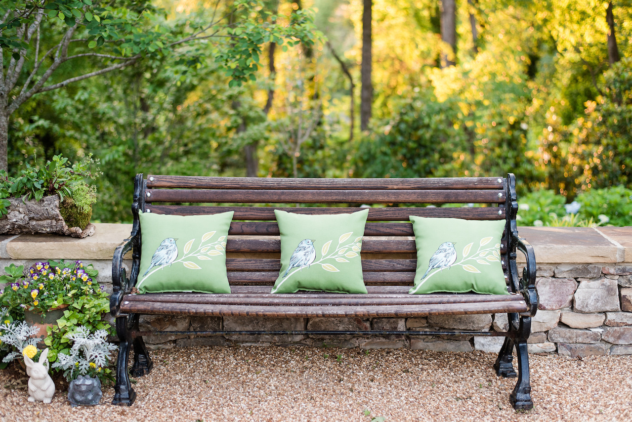 This bench in the herb garden is the perfect spot to rest and breathe in the fresh rosemary and thyme.