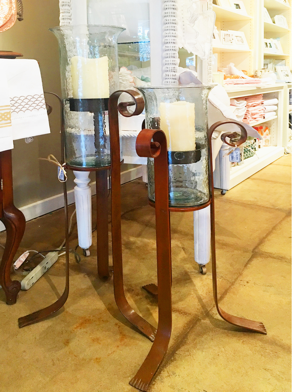 Forged iron candle holder stands, $188.95 for small and $218.95 for large, at The Blue Willow