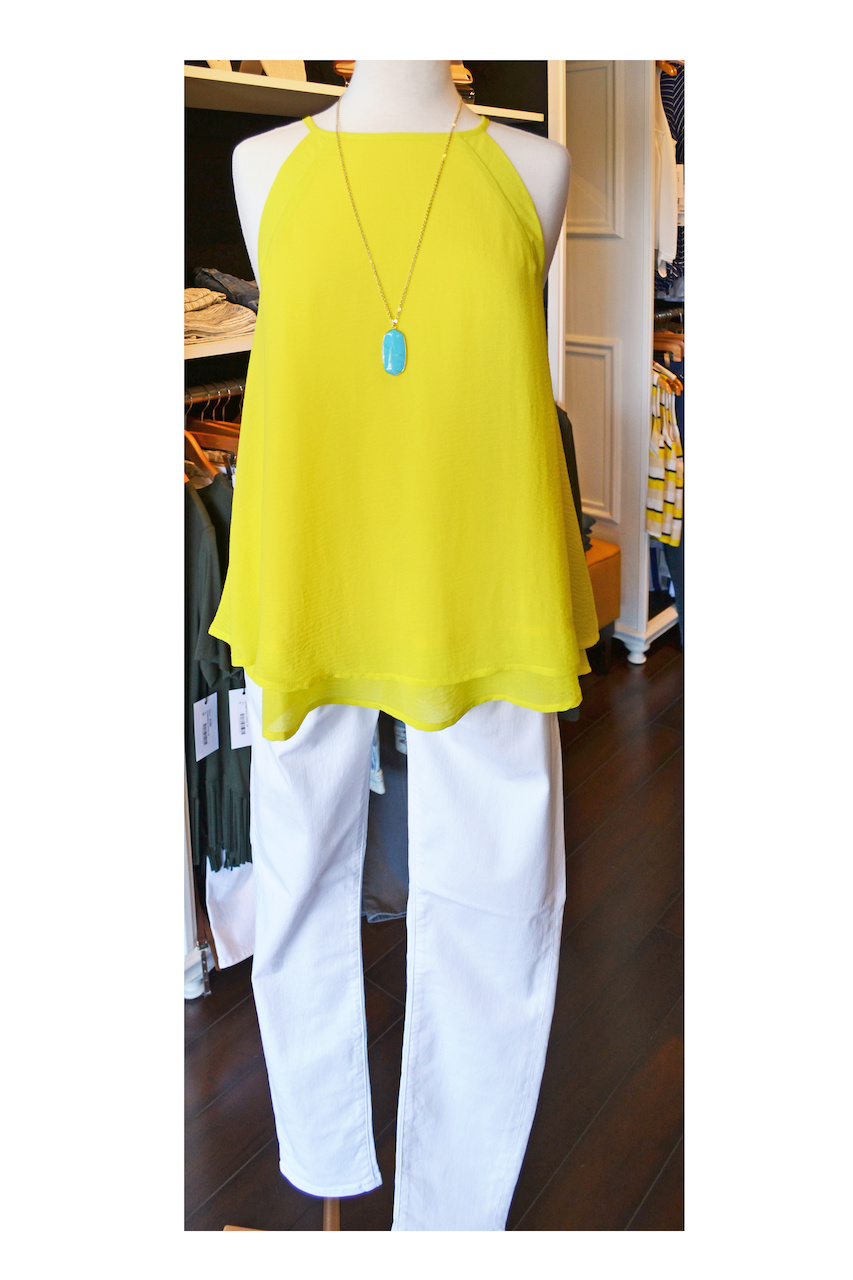 Bright yellow high necked tank top with white jeans is a great summer outfit.