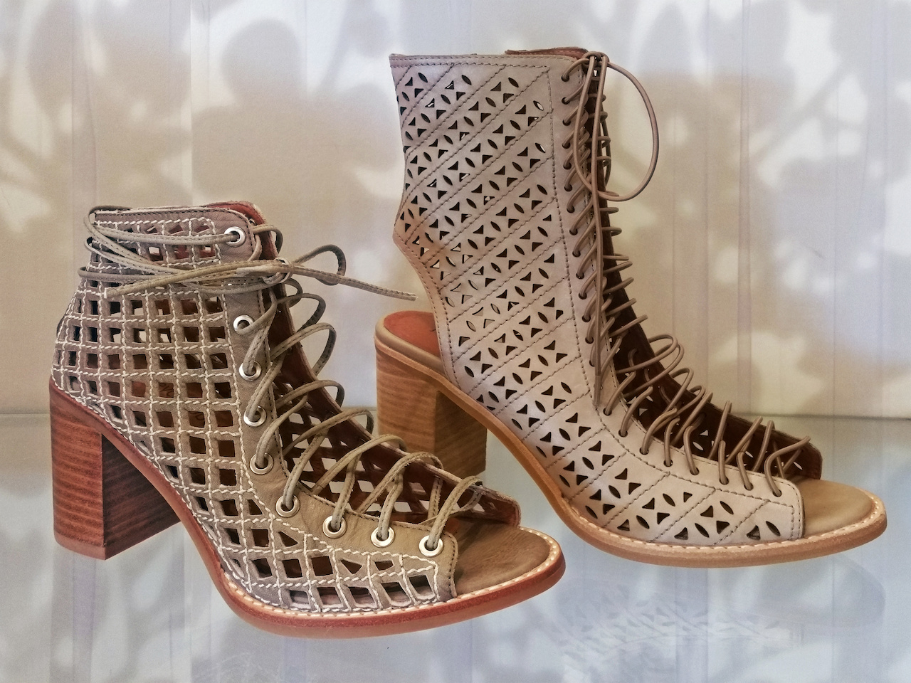 Jeffrey Campbell laser-cut booties, $195 (left) and $215 (right), at Gus Mayer