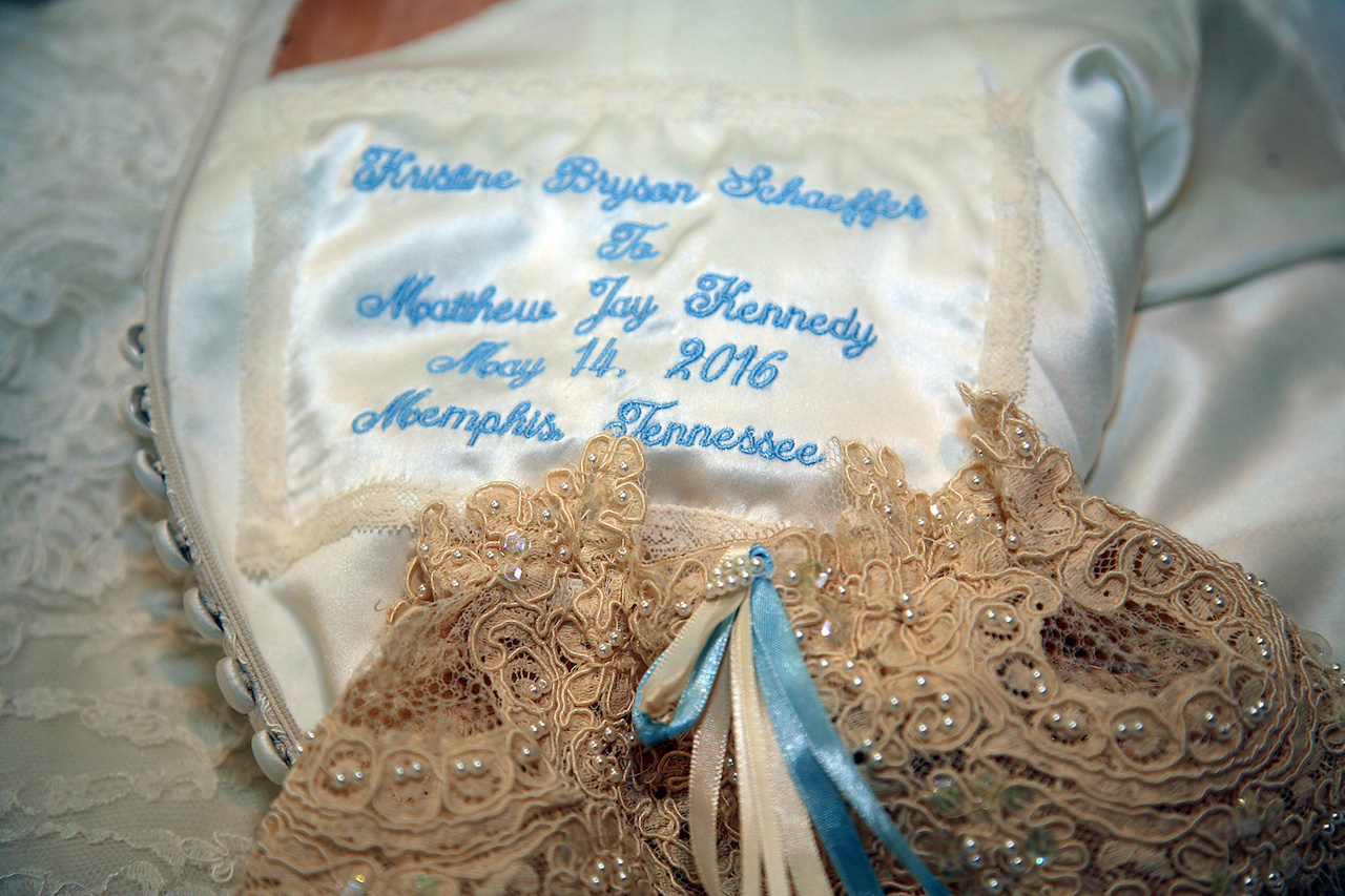 Her garter was something old, borrowed and blue. It was hand made with the lace of her mom's wedding gown and had a blue ribbon tied into it. She had her dress also embroidered (in blue) with their names, wedding date and wedding location. Her garter was something old, borrowed and blue. It was handmade with the lace of her mom's wedding gown and had a blue ribbon tied into it. She had her dress also embroidered (in blue) with their names, wedding date and wedding location.