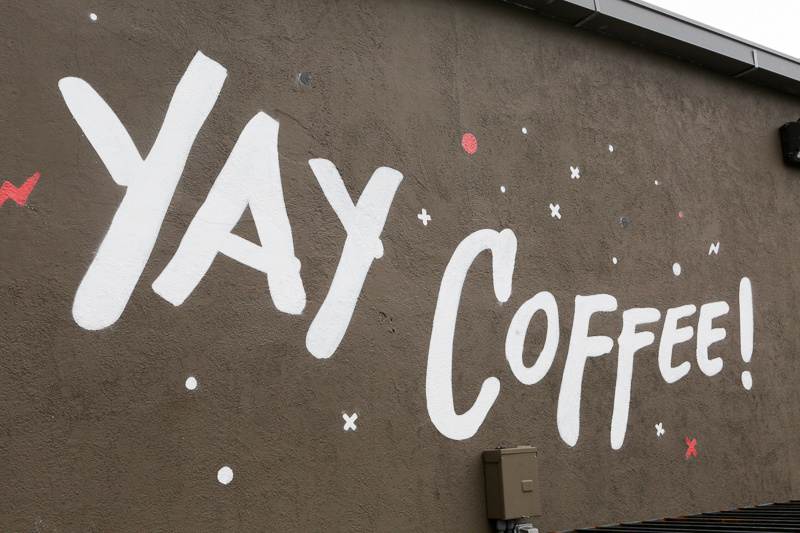 The writing is literally on the wall - and we agree! Yay, coffee!