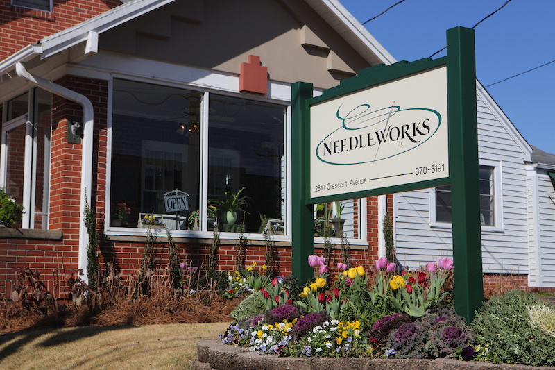 Needleworks is nestled on the outskirts of downtown Homewood in this charming brick cottage.