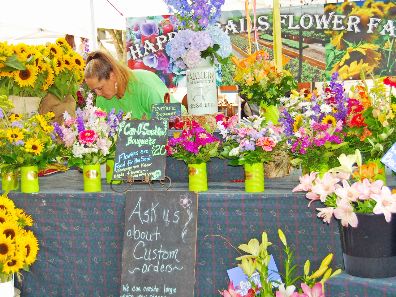 The Happy Trails Flower Farm tent at the Market at Pepper Place offer bouquets to brighten up your weekend!