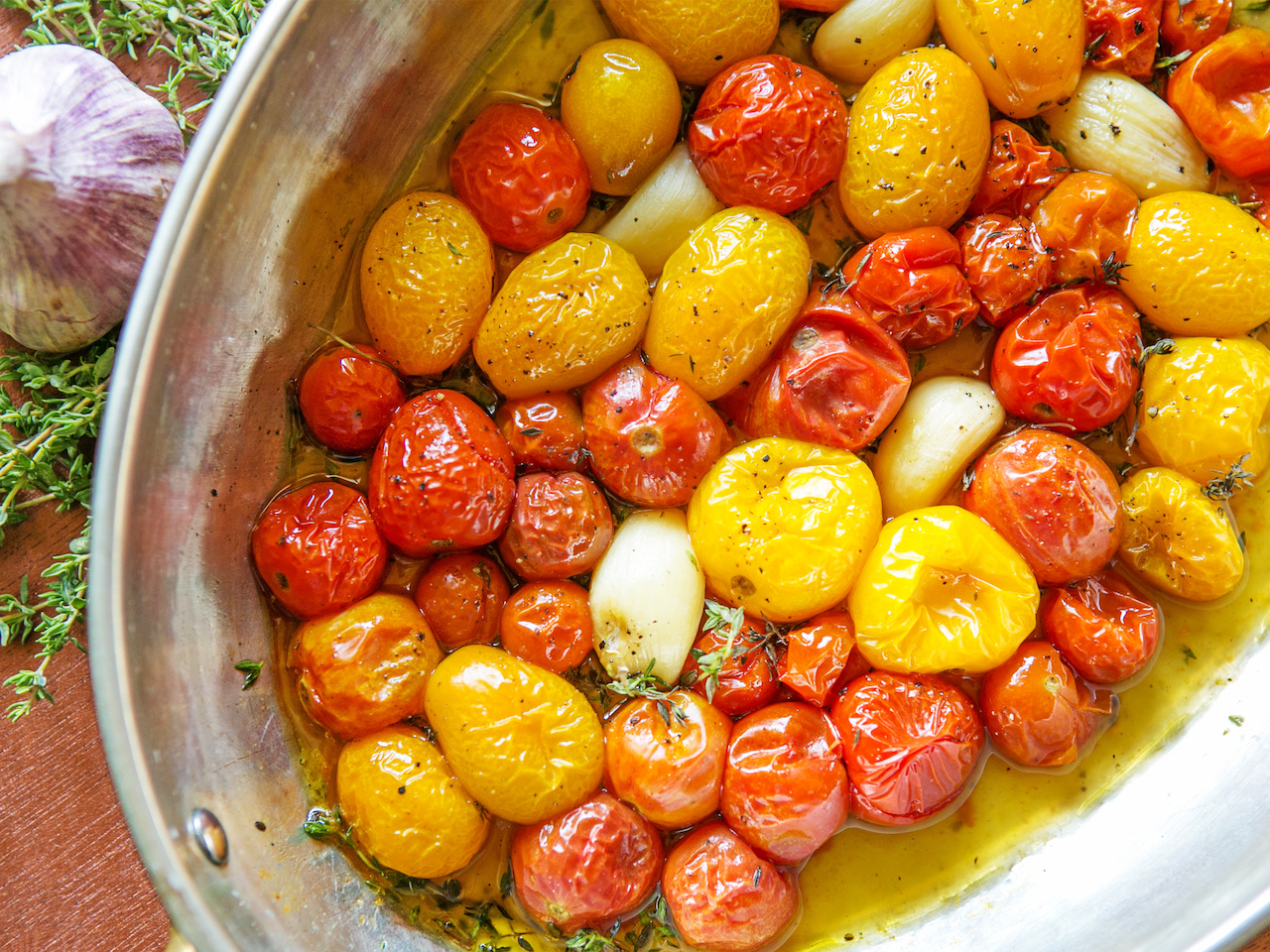These roasted cherry tomatoes with garlic and thyme are almost too pretty to eat!