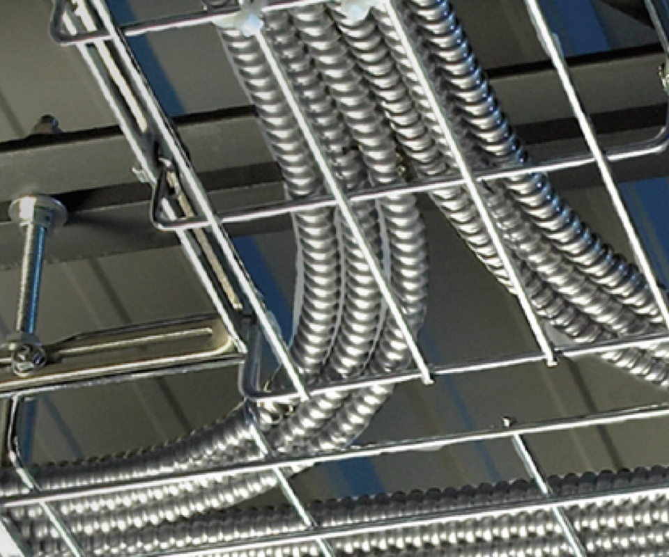 Wire mesh cable tray installed on commercial ceiling