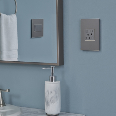 blue bathroom with gray granite sink and gray outlet