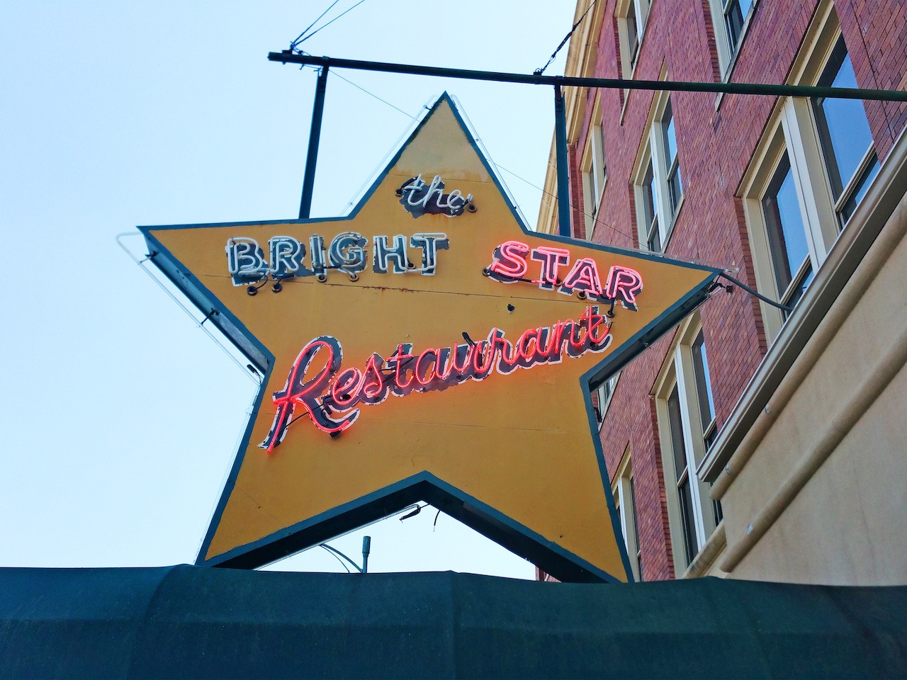 The neon sign that hangs above the awning exudes the charm of a bygone era.