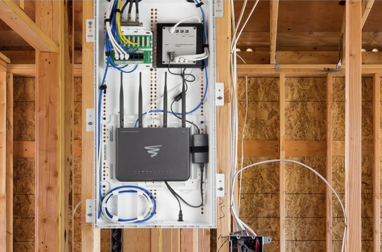 back exterior of structured wiring box in room of wooden beams