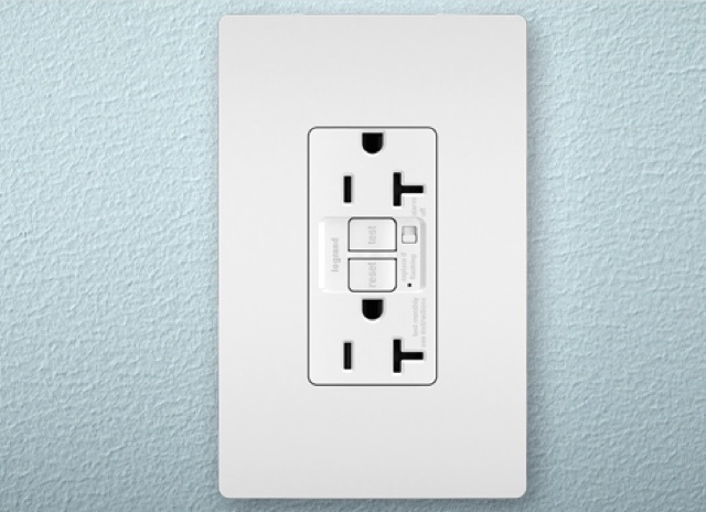 radiant Collection GFCI outlet and screwless wall plate in white on blue background
