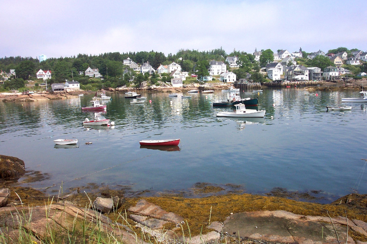 Small boats in calm harbor at Stonington, Maine on south end of Deer Isle