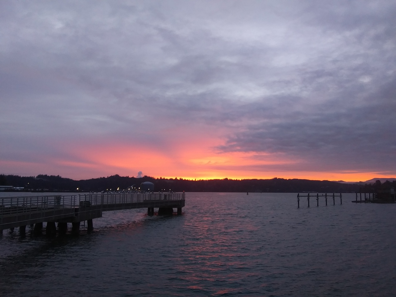 A chilly sunrise over the coast range as we wait to head out on the R/V Elakha. Photo: NOAA Fisheries.