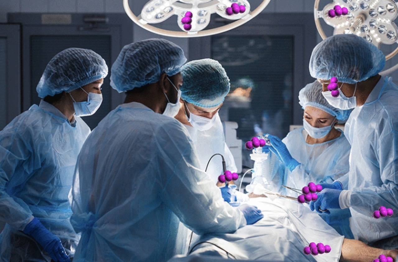 Surgeons in an operating room performing surgery on a patient