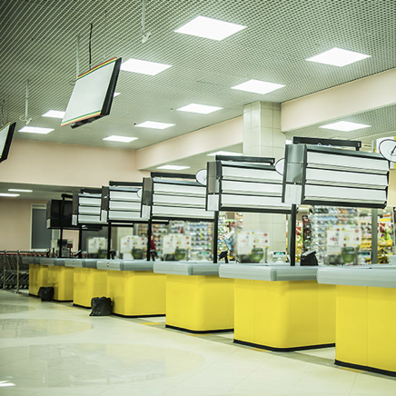 Inside a retail center with yellow booths
