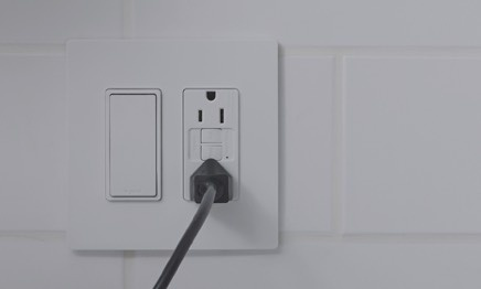 white paddle switch with GFCI outlet