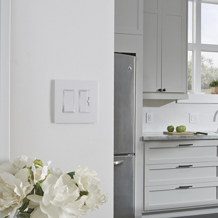 radiant switch and dimmer in modern white kitchen