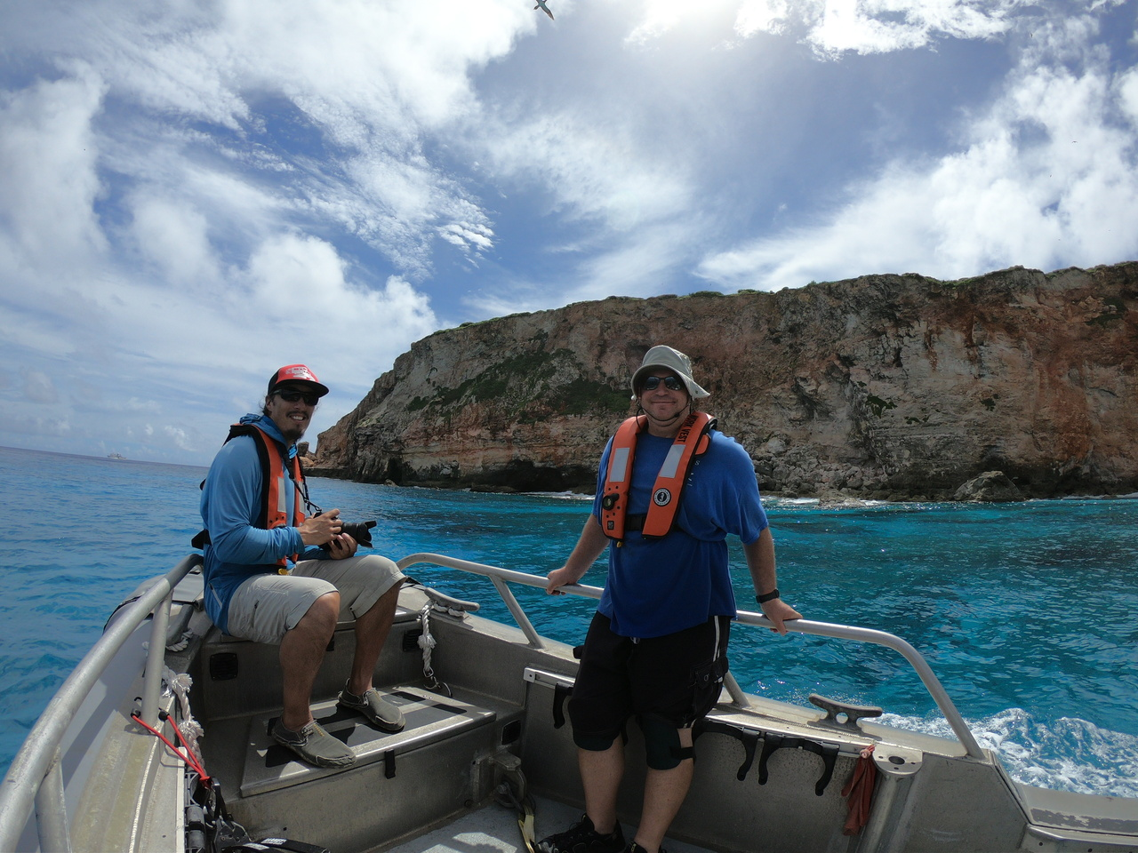 Scientists Adam Ü and Allan Ligon on a small boat near Farallon de Medinilla.
