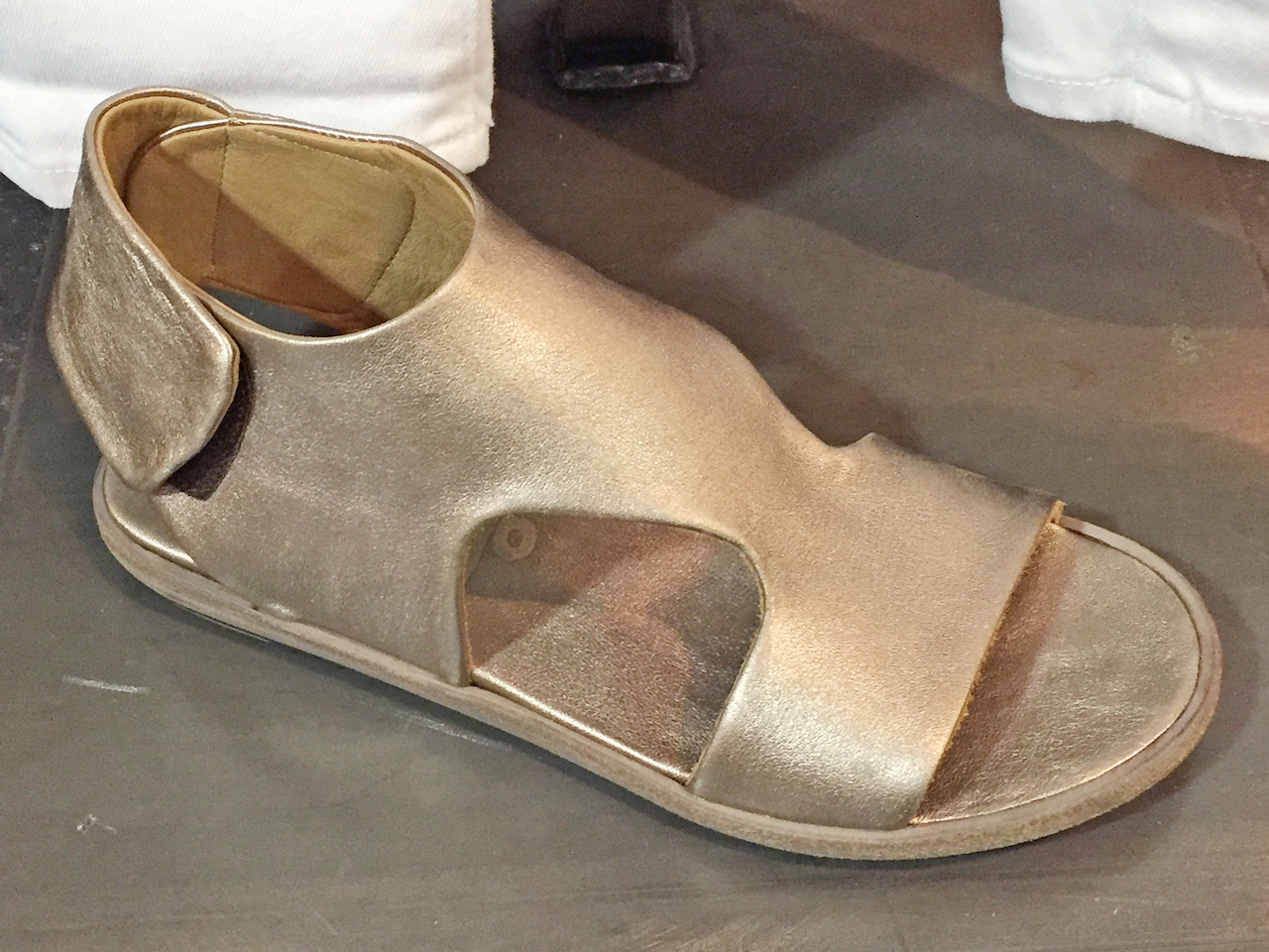 From Betsy Prince: P. Monjo metallic t-strap leather sandal, $398