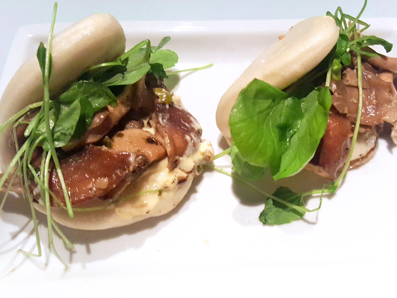 The mushroom buns feature oyster and Shiitake mushrooms, as well as garlic yuzu and aonori